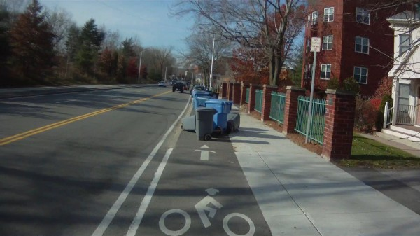 Trash barrels on westbound bikeway on Concord Avenue