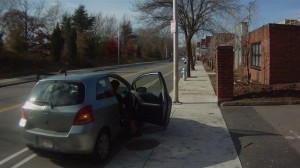 Car stops in bikeway to discharge passengers, on Concord Avenue