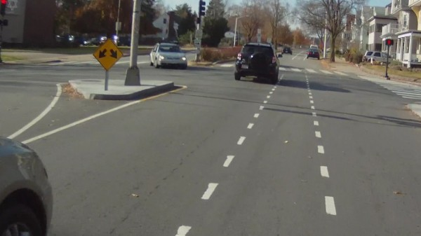 Wide traffic island at Blanchard Road narrows bike lane on Concord Avenue