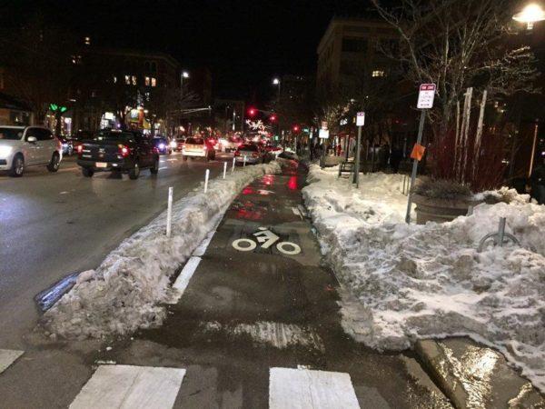 "Snowmelt drains across ""protected"" bikeway on Massachusetts Avenue in Cambridge"